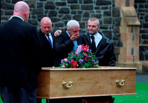 Paul Rodgers, the father of Darren Rodgers (centre) is comforted by mourners after his funeral took place at St Patrick's parish church in Ballymena, Co Antrim. PRESS ASSOCIATION Photo. Picture date: Saturday June 25, 2016. Darren Rodgers, 24, a talented amateur footballer himself, was killed after falling from a seafront wall in Nice in the early hours of June 13. See PA story SPORT EURO2016 Funeral. Photo credit should read: Niall Carson/PA Wire