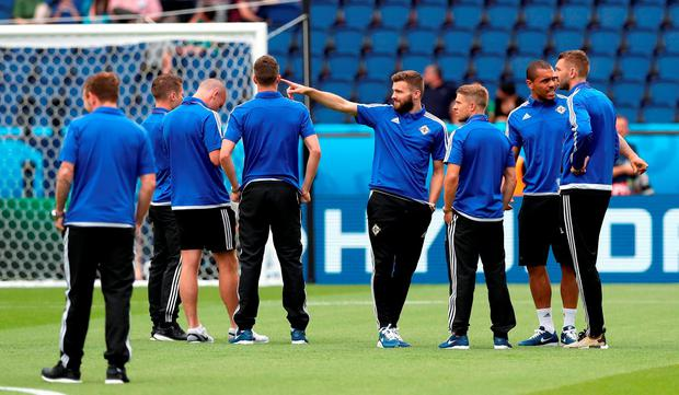 Northern Ireland players on the pitch before the round of 16 match at the Parc de Princes, Paris