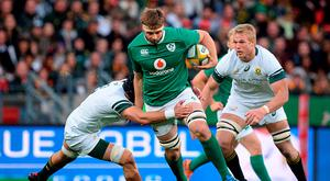 Iain Henderson of Ireland is tackled by Warren Whiteley of South Africa during the 3rd Test