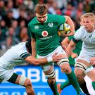 Iain Henderson of Ireland is tackled by Warren Whiteley of South Africa during the 3rd Test between South Africa and Ireland at the Nelson Mandela Bay Stadium in Port Elizabeth, South Africa. Photo by Brendan Moran/Sportsfile