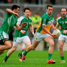 Niall McNamee of Offaly in action against London's from left, James Moran, Ciarán Dunne and Adrian Moyles