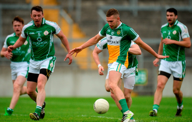 Anton Sullivan of Offaly shoots under pressure from London defenders during the GAA Football All-Ireland Senior Championship Round 1B game between Offaly and London
