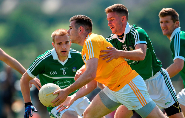 Sean Burke of Antrim is tackled by Paul Hannon of Limerick
