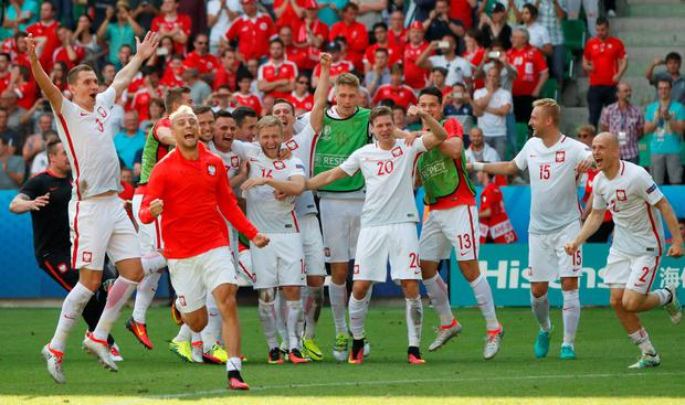 Poland's players celebrate after Poland's Grzegorz Krychowiak scored the decisive penalty