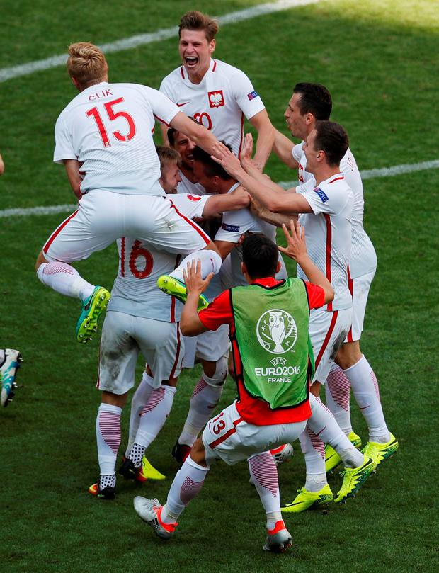 Poland's Grzegorz Krychowiak celebrates with teammates