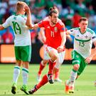 Wales' Gareth Bale battles for the ball with Northern Ireland's Jamie Ward (left) and Corry Evans (right) during the round of 16 match at the Parc de Princes, Paris: Joe Giddens/PA Wire