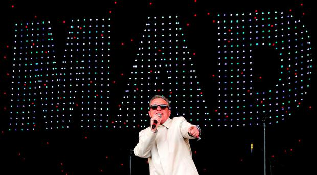 Suggs of Madness performing on the Pyramid Stage at the Glastonbury Festival, at Worthy Farm in Somerset. PRESS ASSOCIATION Photo. See PA story SHOWBIZ Glastonbury. Picture date: Saturday June 25, 2016. Photo credit should read: Ben Birchall/PA Wire