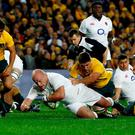 England prop Dan Cole crashes over for an early try against Australia in the third Test in Sydney. Photo: Jason Reed/Reuters