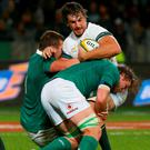 South Africa's Eben Etzebeth is tackled as Ireland defends. Photo: Mike Hutchings/Reuters