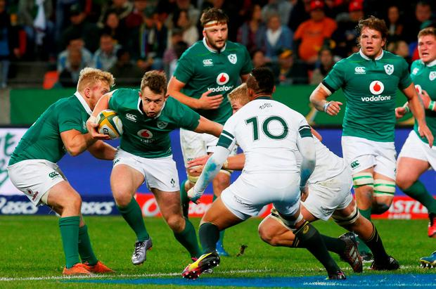 Ireland's Matt Healy attempts to break past the South African defence. Photo: Mike Hutchings/Reuters