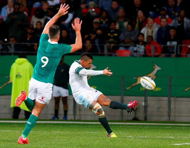 Ireland's Connor Murray attempts to charge down a kick from South Africa's Elton Jantjies. Photo: Mike Hutchings/Reuters