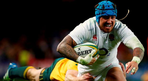 England's Jack Nowell runs with the ball as Australia's Dane Haylett-Petty tries to tackle him during the second half. Photo: David Gray/Reuters