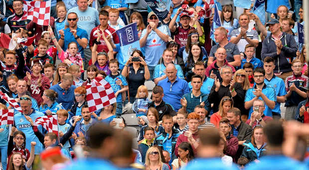Dublin and Westmeath supporters cheer on their sides. Photo: Brendan Moran / Sportsfile