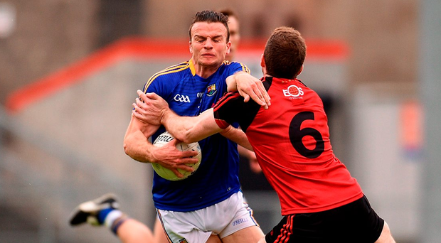 Donal McElligott of Longford collides with Down's Aidan Carr. Photo: Paul Mohan/Sportsfile