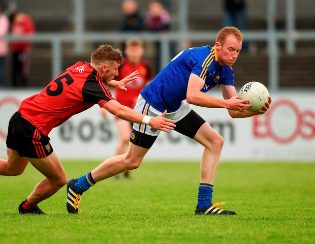 Longford's Barry O'Farrell in action against Down's Barry O'Hagan. Photo: Paul Mohan/Sportsfile
