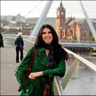 Span of history: Kathy Donaghy at the Peace Bridge spanning the River Foyle in Derry. Photo: Tevor McBride