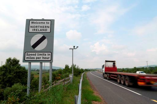 North and south: Traffic passes a border sign at Newry. Photo: Getty