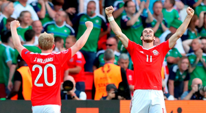 Gareth Bale and Jonathan Williams celebrate after the goal that decided their last 16 clash with Northern Ireland. Photo: Martin Rickett/PA Wire