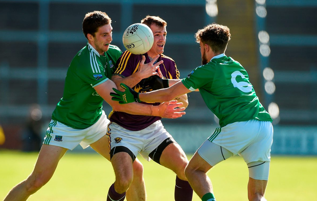 Wexford's Adrian Flynn gets surrounded by Fermanagh's Eoin Donnelly and James McMahon. Photo: Diarmuid Greene/Sportsfile
