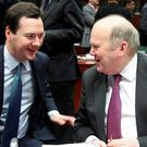 No more cosy chats: British Chancellor of the Exchequer George Osborne, left, talks with Finance Minister Michael Noonan during the EU finance ministers' meeting in Brussels. Photo: AP