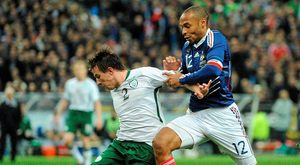 Sean St. Ledger, Republic of Ireland, in action against Thierry Henry in 2010. Photo:Stephen McCarthy/Sportsfile