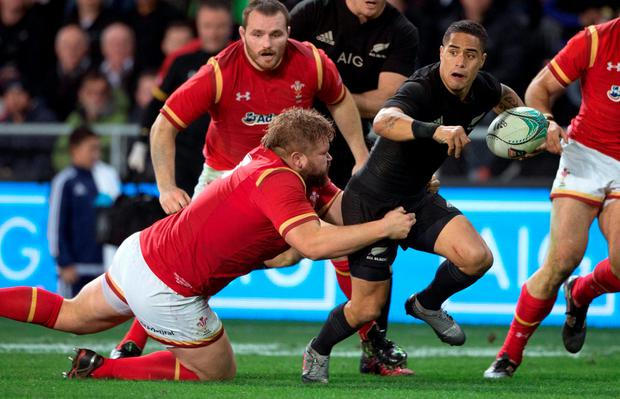 New Zealand All Blacks' halfback Aaron Smith tries to evade the Welsh. Photo: Brett Phibbs/New Zealand Herald via AP
