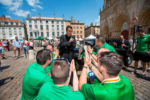 Irish fans from Dublin getting a blessing from Fr Jean Babtiste Aubert in Lyon ahead of Ireland's Euro 2016 clash with France