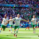Republic of Ireland's Robbie Brady (centre) celebrates scoring his side's first goal of the game during the round of 16 match at the Stade de Lyon, Lyon.