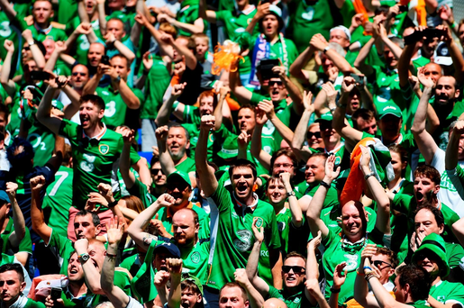 Ireland supporters celebrate Robbie Brady's opener (Photo by Laurence Griffiths/Getty Images)