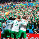 The Irish players celebrate in front of their supporters PRESS ASSOCIATION Photo.
