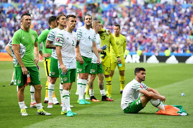LYON, FRANCE - JUNE 26: Dejected Republic of Ireland players are seen in front of their supporters after their team's 1-2 defeat in the UEFA EURO 2016 round of 16 match between France and Republic of Ireland at Stade des Lumieres on June 26, 2016 in Lyon, France. (Photo by Laurence Griffiths/Getty Images)