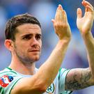 Robbie Brady of the Republic of Ireland applauds the travelling Irish support after defeat to France in the UEFA Euro 2016 Round of 16 match between France and Republic of Ireland at Stade des Lumieres in Lyon, France. Photo by Stephen McCarthy/Sportsfile