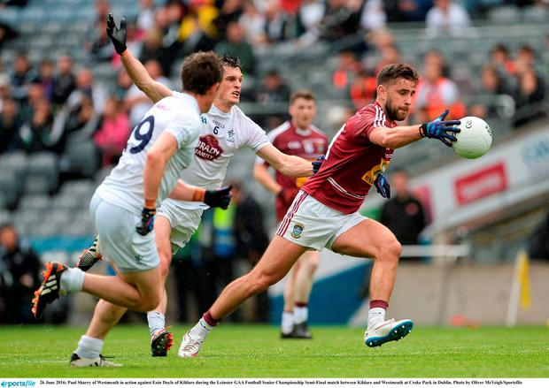Paul Sharry of Westmeath in action against Eoin Doyle of Kildare