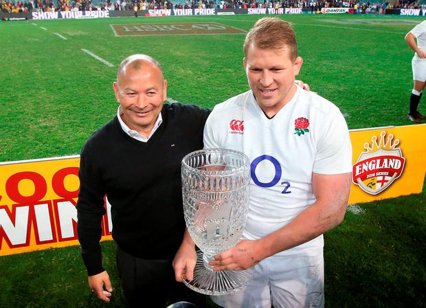 England's coach Eddie Jones, left, celebrates with captain Dylan Hartley after their clean sweep of Australia in their rugby union test series in Sydney. Picture: AP Photo/Rick Rycroft