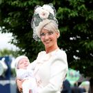 Eva Hayes Morrissey from Castletroy, Co Limerick, with her 10-week-old son Tristan after winning the Best Dressed Competition at the 2016 Dubai Duty-Free Irish Derby. Photo: Maxwells