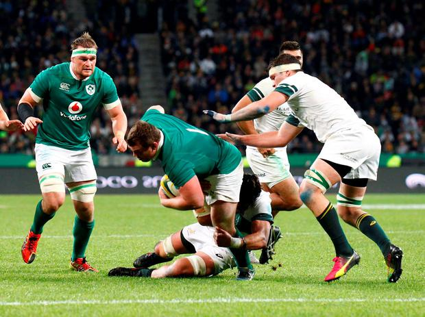 Jack McGrath of Ireland is tackled by Franco Mostert of the Springboks. AFP PHOTO / MICHAEL SHEEHANMICHAEL SHEEHAN/AFP/Getty Images