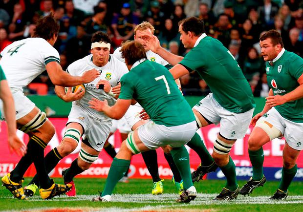 Springboks' Franco Mostert drives the ball. / AFP PHOTO / MICHAEL SHEEHANMICHAEL SHEEHAN/AFP/Getty Images