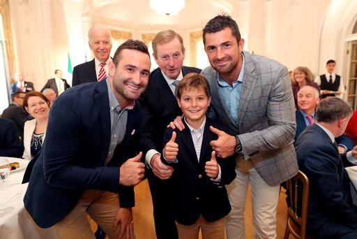 Hunter, grandson of US Vice President Joe Biden (rear left) is introduced to Irish rugby stars Dave and Rob Kearney by Taoiseach Enda Kenny at a farewell lunch in Farmleigh House