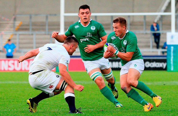 Johnny McPhillips of Ireland in action against Will Evans of England. Photo by Matt McNulty/Sportsfile