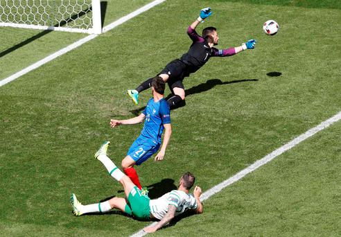 Daryl Murphy just fails to make contact with a cross as Hugo Lloris gets the ball clear. Photo: Reuters