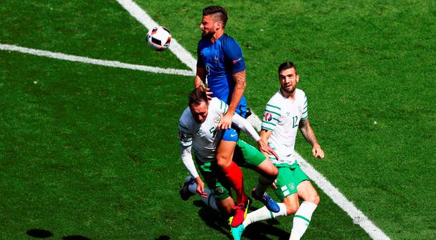 Olivier Giroud leaps highest to set up Antoine Griezmann for what proved to be France's winning goal. Photo: Lars Baron/Getty Images