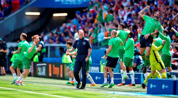 Roy Keane leaps with delight in the celebrations after Robbie Brady's early goal in Lyon. Photo: Nick Potts/PA Wire