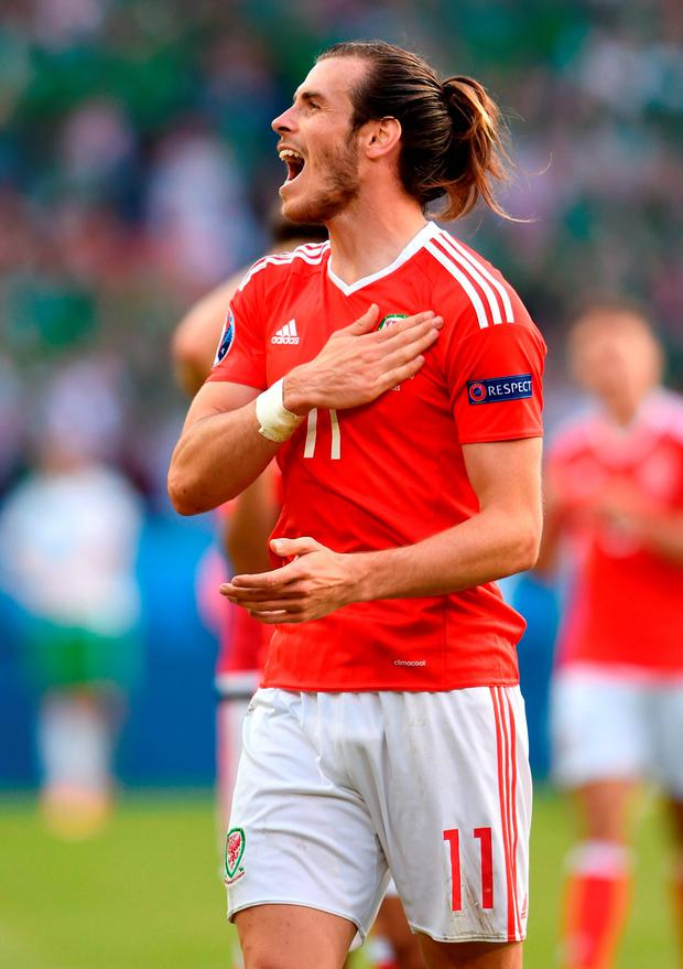 Wales' Gareth Bale celebrates on the pitch after the match. Photo: Joe Giddens/PA Wire.
