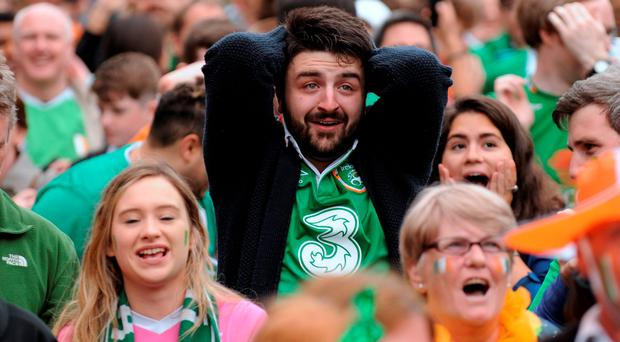 Fans in Smithfield Square watching just before Ireland took their penalty after two minutes. Photo: Caroline Quinn