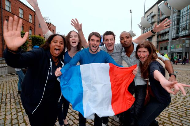 French fans celebrate after watching the match in Smithfield Square. Picture: Caroline Quinn