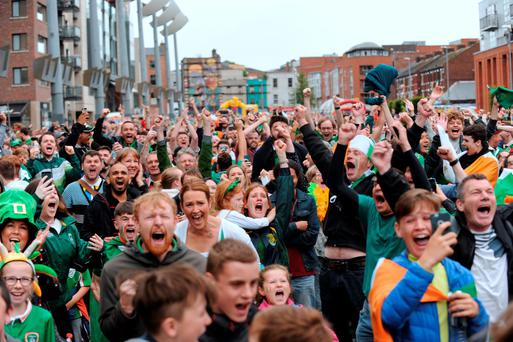 Fans at Smithfield Square celebrate after Ireland scored. Picture: Caroline Quinn