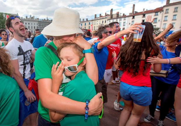Noreen Harvey consoles her distraught son Senan from Mallow in Cork. Photo: Mark Condren