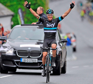 Nicolas Roche celebrates as he crosses the finishing line to win the National Road Race Championship in Kilcullen. Photo: Stephen McMahon / Sportsfile