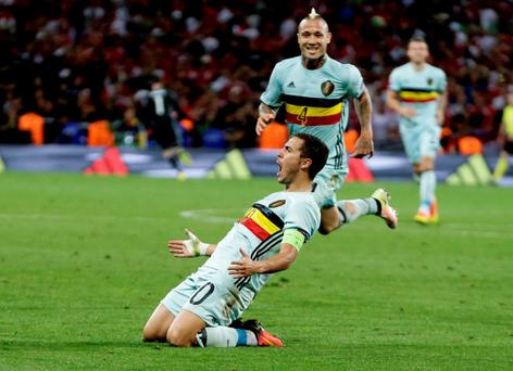 Belgium's Eden Hazard celebrates after scoring his side's third goal during the Euro 2016 round of 16 soccer match between Hungary and Belgium, at the Stadium municipal in Toulouse. (AP Photo/Petr David Josek)