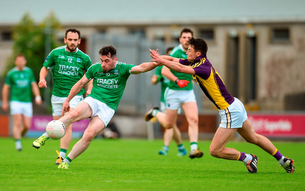 Barry Mulrone of Fermanagh in action against Eoghan Nolan of Wexford. Photo by Diarmuid Greene/Sportsfile